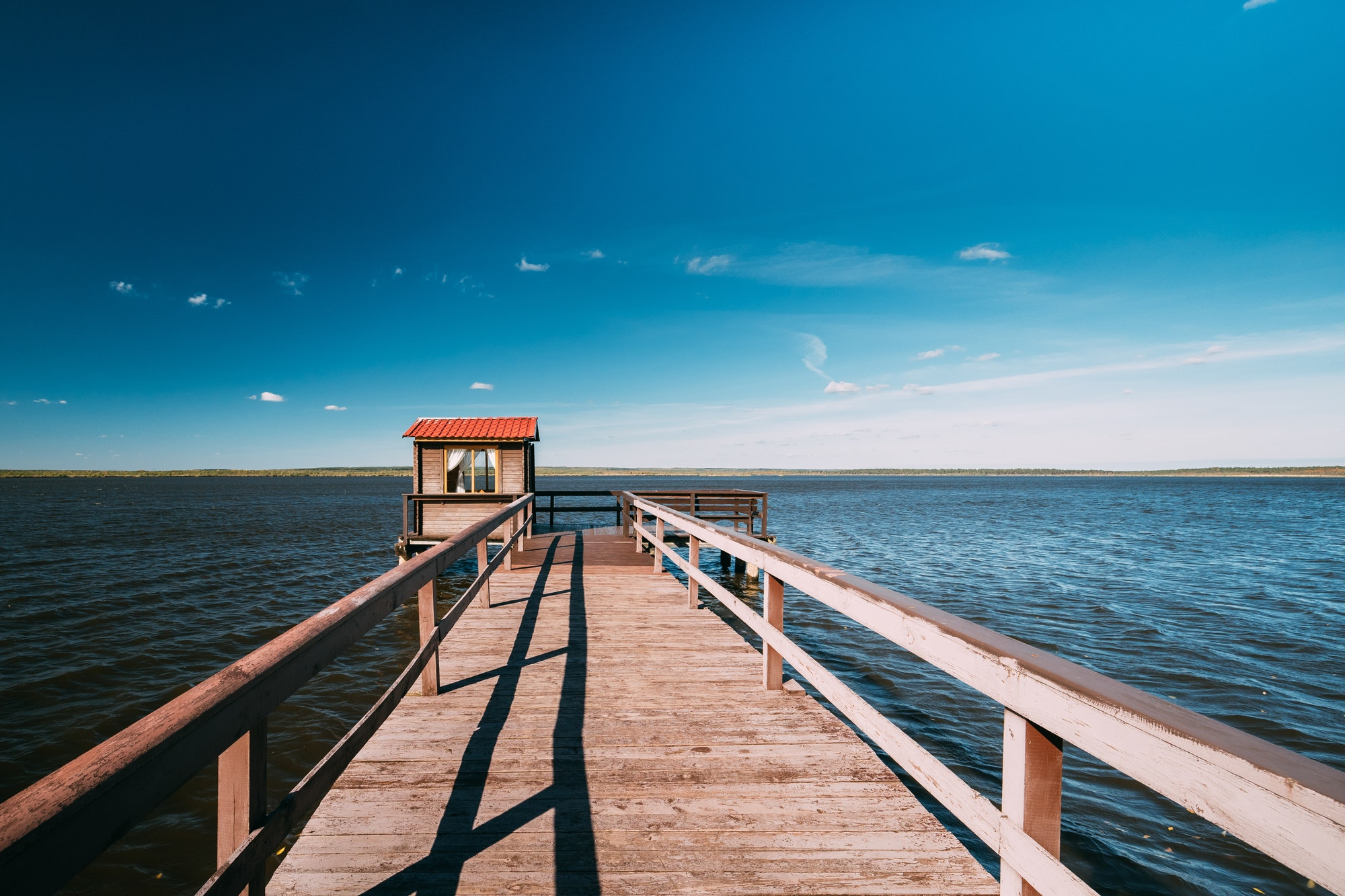 Wooden Pier For Fishing, Small House Shed And Beautiful Lake Or